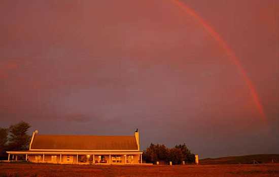 Great sunset with rainbow at RiverBend Lodge